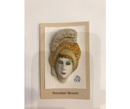 Porcelain brooch - lady with the feather